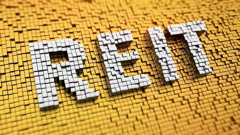 Pixelated acronym REIT made from cubes, mosaic pattern
