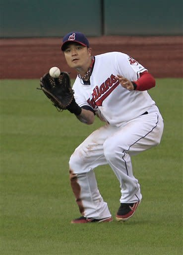 Cleveland Indians' Shin-Soo Choo, of South Korea, catches a fly ball hit by Tampa Bay Rays' Will Rhymes in the second inning in a baseball game, Friday, July 6, 2012, in Cleveland. (AP Photo/Tony Dejak)