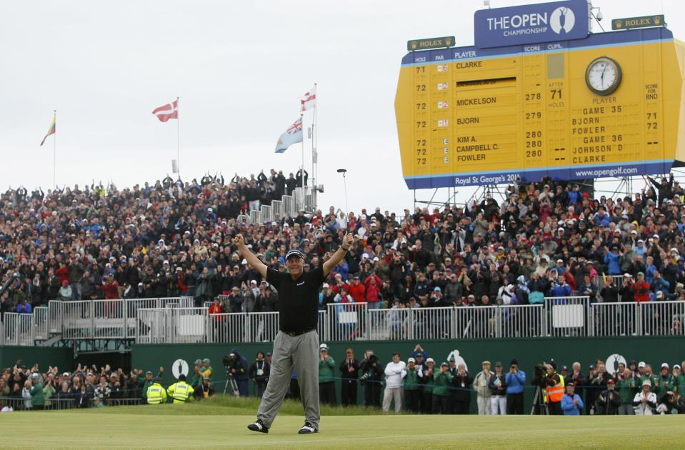 FILE - Northern Ireland's Darren Clarke reacts on the 18th green after winning the British Open Golf Championship at Royal St George's golf course in Sandwich, England, in this Sunday, July 17, 2011, file photo. The British Open, canceled last year by the pandemic, returns to Royal St. George's this year. (AP Photo/Jon Super, File)