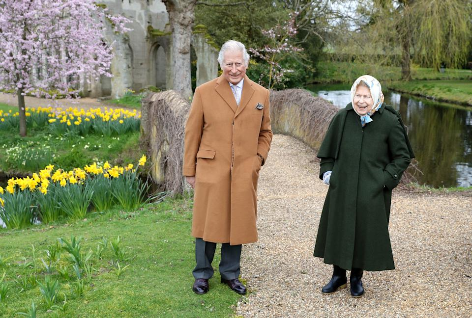 In this handout image released on April 2, 2021, Queen Elizabeth II and Prince Charles, Prince of Wales pose for a portrait in the garden of Frogmore House, on March 23, 2021 in Windsor, England. (Photo by Chris Jackson/Getty Images)