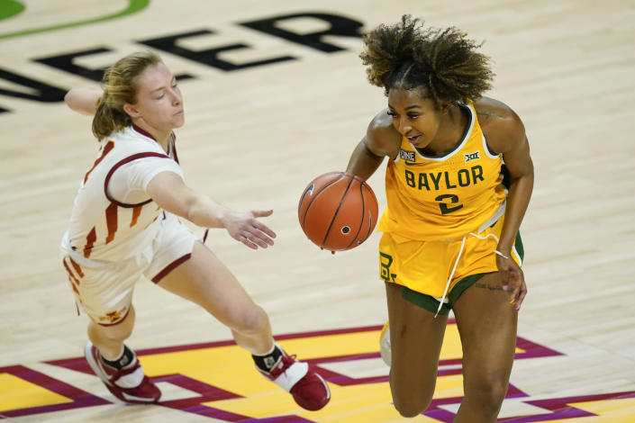 Baylor guard DiDi Richards (2) drives past Iowa State guard Emily Ryan, left, during the second half of an NCAA college basketball game, Sunday, Jan. 31, 2021, in Ames, Iowa. Baylor won 85-77. (AP Photo/Charlie Neibergall)