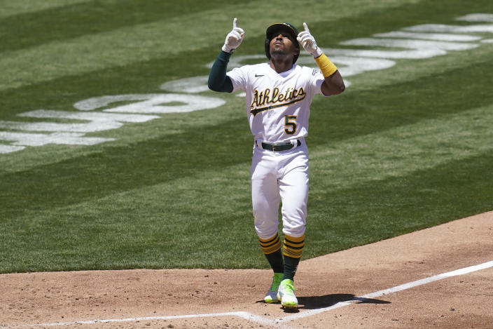 Oakland Athletics' Tony Kemp celebrates after hitting a home run against the Houston Astros during the third inning of a baseball game in Oakland, Calif., Thursday, May 20, 2021. (AP Photo/Jeff Chiu)