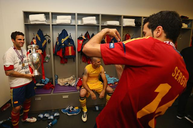 KIEV, UKRAINE - JULY 01: Cesc Fabregas of Spain poses in the dressing room with the trophy following the UEFA EURO 2012 final match between Spain and Italy at the Olympic Stadium on July 1, 2012 in Kiev, Ukraine. (Photo by Handout/UEFA via Getty Images)