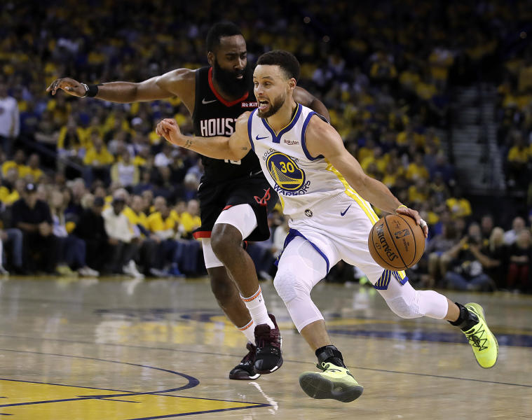 Golden State Warriors' Stephen Curry, right, drives the ball against Houston Rockets' James Harden during the second half of Game 5 of a second-round NBA basketball playoff series Wednesday, May 8, 2019, in Oakland, Calif. (AP Photo/Ben Margot)