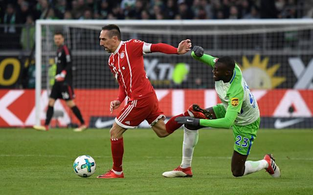 Soccer Football - Bundesliga - VfL Wolfsburg vs Bayern Munich - Volkswagen Arena, Wolfsburg, Germany - February 17, 2018 Bayern Munich's Franck Ribery in action with Wolfsburg's Josuha Guilavogui REUTERS/Fabian Bimmer DFL RULES TO LIMIT THE ONLINE USAGE DURING MATCH TIME TO 15 PICTURES PER GAME. IMAGE SEQUENCES TO SIMULATE VIDEO IS NOT ALLOWED AT ANY TIME. FOR FURTHER QUERIES PLEASE CONTACT DFL DIRECTLY AT + 49 69 650050
