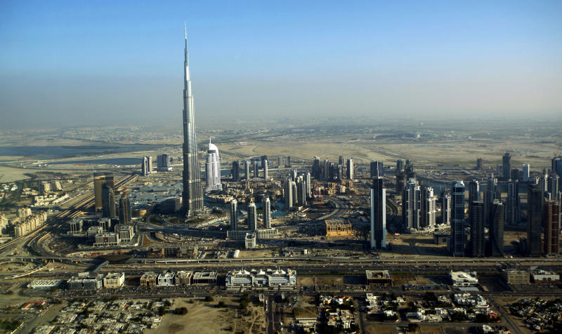 FILE - This Sunday, Jan. 3, 2010 file photo shows the Burj Dubai, the world's tallest building, in Dubai, United Arab Emirates. It suddenly seems like Dubai is rediscovering its old habits. That means breathless hype is now back in vogue. Construction plans are again peppered with superlatives. (AP Photo/Kamran Jebreili, File)