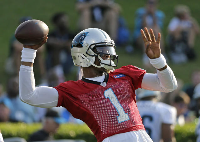 Carolina Panthers quarterback Cam Newton looks to throw a pass during practice at NFL football training camp at Wofford College in Spartanburg, S.C., Wednesday, July 26, 2017. (AP Photo/Chuck Burton)