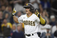 San Diego Padres second baseman Ha-Seong Kim (7) celebrates after hitting a solo home run during the fifth inning of a baseball game against Los Angeles Dodgers Tuesday, June 22, 2021, in San Diego. (AP Photo/Denis Poroy)