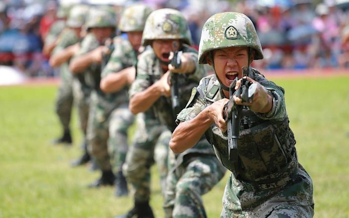 Soldiers of the People's Liberation Army (PLA) perform drills during a demonstration at an open day at the PLA Ngong Shuen Chau Barracks in Hong Kong - Visual China Group