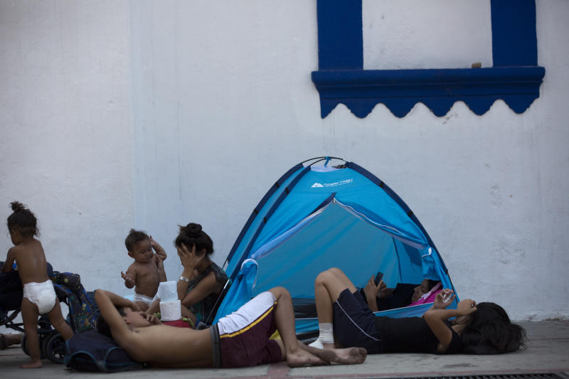 Central American migrants traveling in a caravan to the U.S. rest in the San Francisco Catholic church in Tonala, Chiapas State, Mexico, Tuesday, April 23, 2019. Central American migrants traveling through southern Mexico toward the U.S. on Tuesday fearfully recalled their frantic escape from police the previous day, scuttling under barbed wire fences into pastures and then spending the night in the woods after hundreds were detained in a raid. (AP Photo/Moises Castillo)
