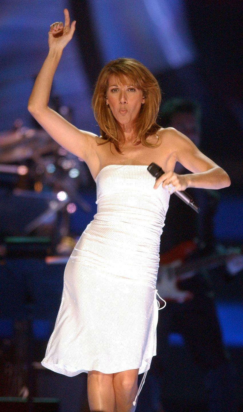 <p>Sometimes simple is better, and this look is proof. Celine styled a shimmery strapless dress with minimal accessories. When the flirty fabric of the dress glides with each of her dance moves, who needs tons of baubles?</p>