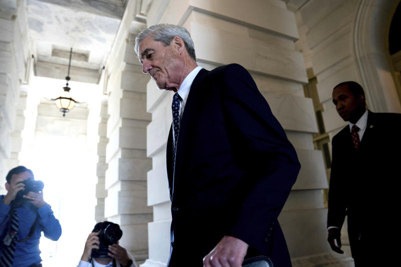 FILE - In this June 21, 2017, file photo, former FBI Director Robert Mueller, the special counsel probing Russian interference in the 2016 election, departs Capitol Hill following a closed door meeting in Washington. While the country waits to see if President Donald Trump will sit for an interview with prosecutors, scores of people sucked into the investigation are waiting for their own signal from special counsel Mueller: whether he's done with them or not.  (AP Photo/Andrew Harnik, File)