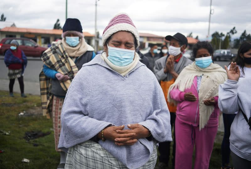 Family members of inmates wait for information on their loved ones, after a riot at the penitentiary Cotopaxi No 1, in Latacunga