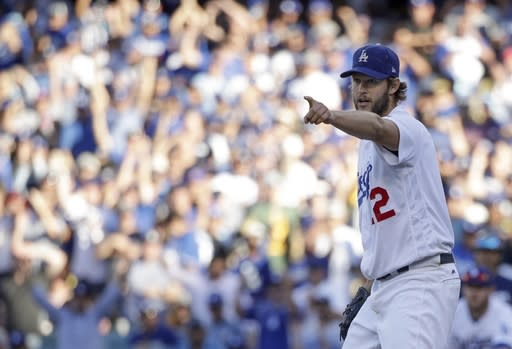 Los Angeles Dodgers' Clayton Kershaw gestures after an out during the seventh inning of Game 5 of the National League Championship Series baseball game against the Milwaukee Brewers Wednesday, Oct. 17, 2018, in Los Angeles. (AP Photo/Jae Hong)