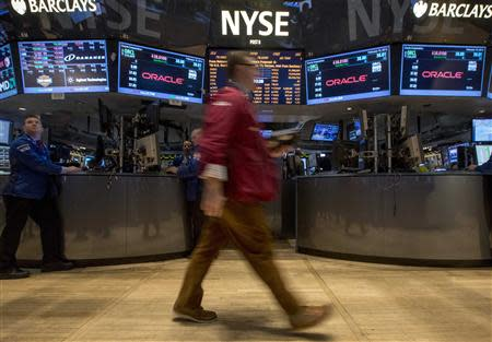 Traders work on the floor of the New York Stock Exchange February 19, 2014. REUTERS/Brendan McDermid