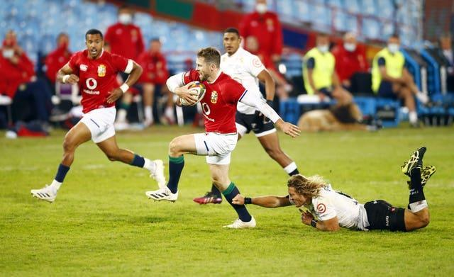 British and Irish Lions' Elliot Daly escapes a tackle from Cell C Sharks' Werner Kok