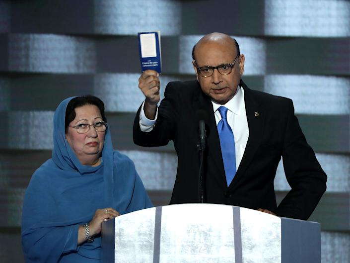 Khizr Khan, father of deceased Muslim U.S. Soldier Humayun S. M. Khan, holds up a booklet of the US Constitution as he delivers remarks on the fourth day of the Democratic National Convention at the Wells Fargo Center, July 28, 2016 in Philadelphia, Pennsylvania.