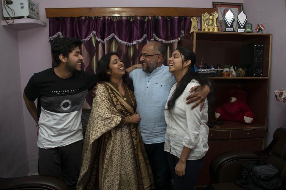 Associated Press photographer Channi Anand celebrates with his family Tuesday, April 5, 2020, following the announcement that he was one of three AP photographers who won the Pulitzer Prize in Feature Photography for their coverage of the conflict in Kashmir and in Jammu, India. (AP Photo)