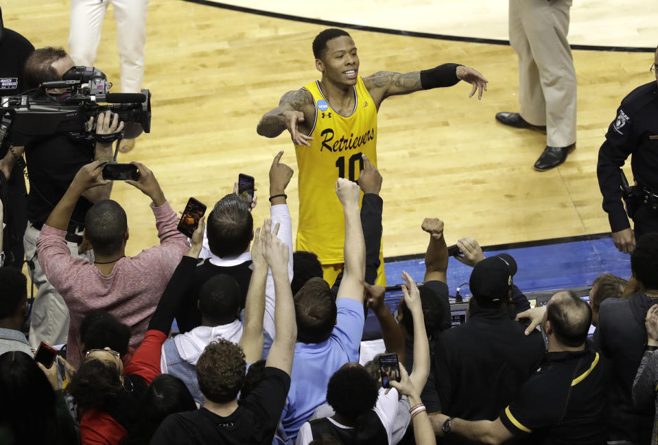 UMBC's Jairus Lyles (10) celebrates with fans after the team's 74-54 win over Virginia. (AP)