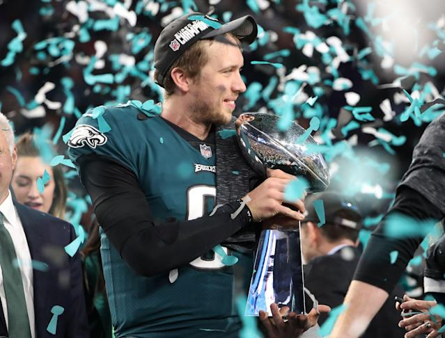 NFL Football - Philadelphia Eagles v New England Patriots - Super Bowl LII - U.S. Bank Stadium, Minneapolis, Minnesota, U.S. - February 4, 2018. Philadelphia Eagles' Nick Foles celebrates winning Super Bowl LII with the Vince Lombardi Trophy. REUTERS/Chris Wattie
