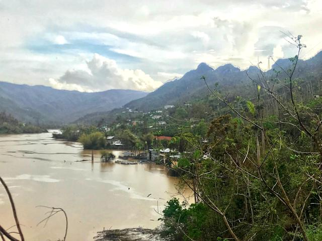 <p>Three weeks after Hurricane Maria tore through Puerto Rico, causing several mudslides in island's central mountain region, the river in the Rio Arriba barrio of Arecibo is motionless and filled with mud and other debris. (Photo: Caitlin Dickson/Yahoo News) </p>