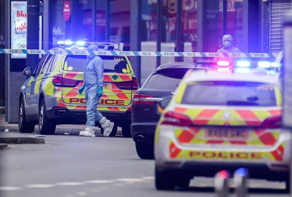 Police on the scene at Streatham High Road, London, following the knife attack (Picture: SWNS)