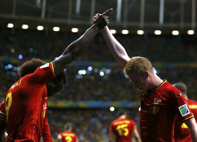 Belgium's Romelu Lukaku celebrates with Kevin De Bruyne (R) after scoring a goal during extra time in the 2014 World Cup round of 16 game between Belgium and the U.S. at the Fonte Nova arena in Salvador July 1, 2014. REUTERS/Marcos Brindicci (BRAZIL - Tags: TPX IMAGES OF THE DAY SOCCER SPORT WORLD CUP) TOPCUP