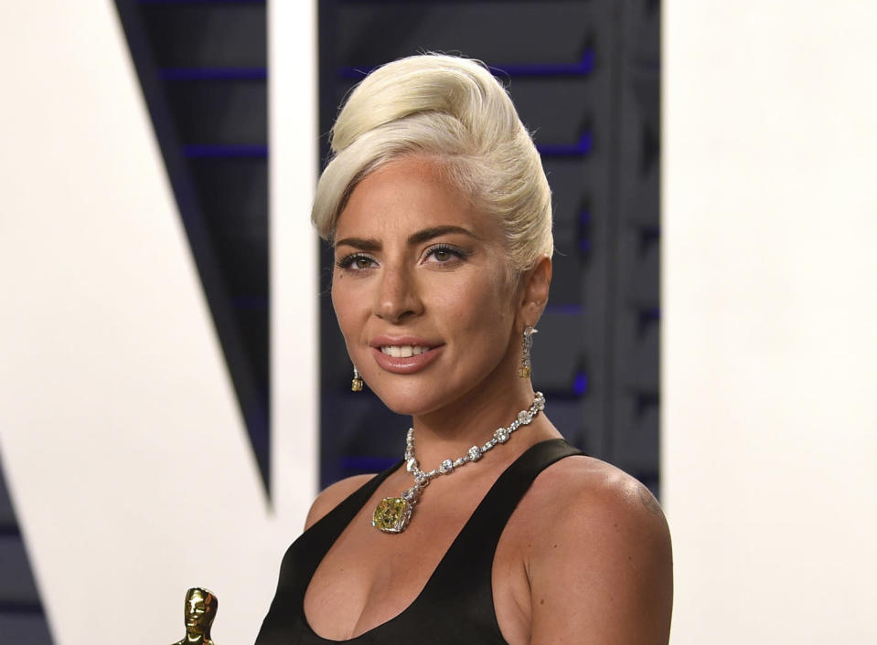"""FILE - Lady Gaga, winner of the award for best original song """"Shallow,"""" arrives at the Vanity Fair Oscar Party on Sunday, Feb. 24, 2019, in Beverly Hills, Calif. The South Korean boy band BTS HAS won a leading four awards including best song for """"Dynamite"""" and best group at the MTV Europe Music Awards Sunday, Nov. 8, 2020 while Lady Gaga took home the best artist prize.(Photo by Evan Agostini/Invision/AP, File)"""