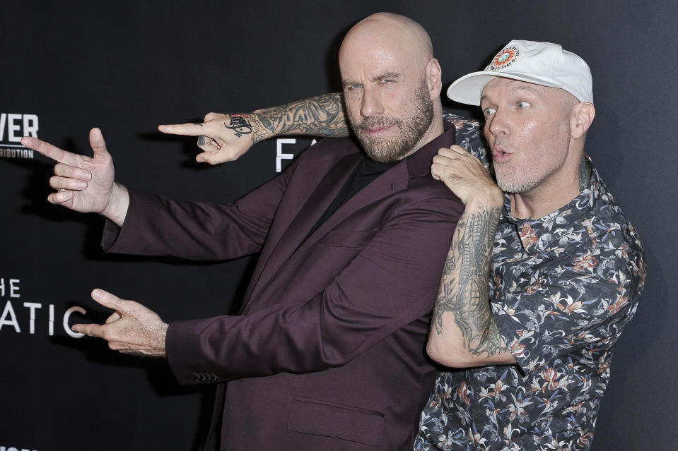 """John Travolta, left, and Fred Durst attend the LA premiere of """"The Fanatic"""" at the Egyptian Theatre on Thursday, Aug. 22, 2019, in Los Angeles. (Photo by Richard Shotwell/Invision/AP)"""