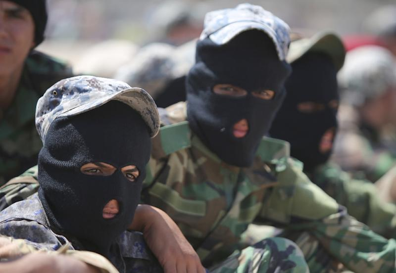 Shiite volunteers from the Iraqi Ketaeb Hezbollah join the army to fight the Islamic State group, in Baghdad on July 9, 2014