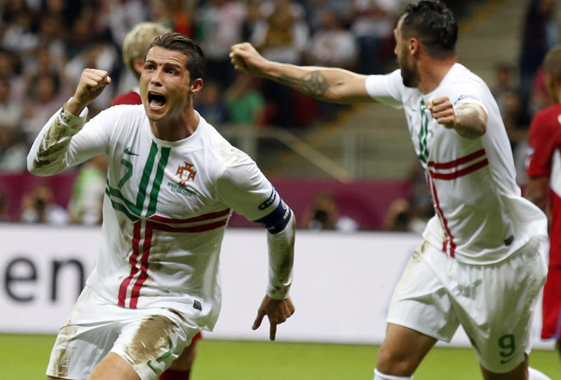 Portugal's Cristiano Ronaldo celebrates after scoring a goal during the Euro 2012 soccer championship quarterfinal match between Czech Republic and Portugal in Warsaw, Poland, Thursday, June 21, 2012. (AP Photo/Armando Franca)