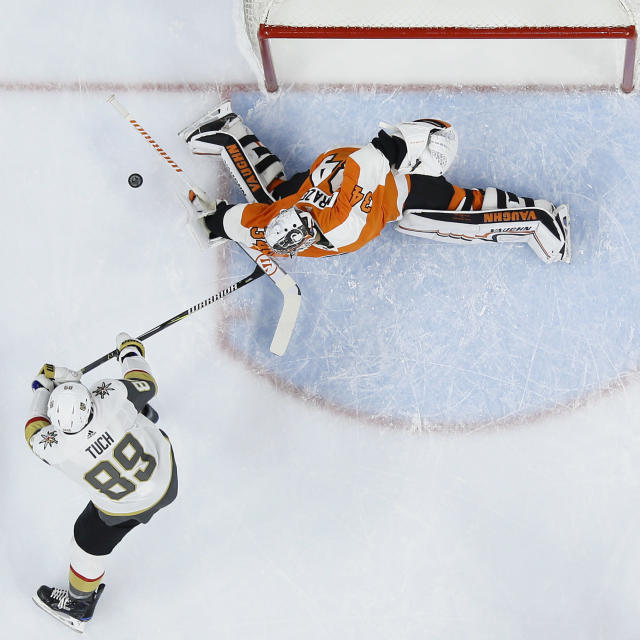Philadelphia Flyers' Petr Mrazek (34) blocks a shot by Vegas Golden Knights' Alex Tuch (89) during the first period of an NHL hockey game, Monday, March 12, 2018, in Philadelphia. (AP Photo/Matt Slocum)