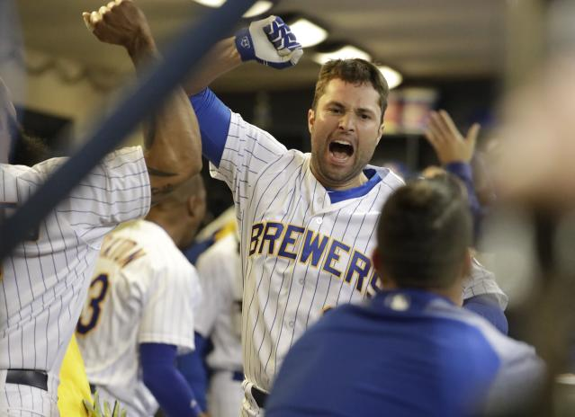 "<a class=""link rapid-noclick-resp"" href=""/mlb/players/8571/"" data-ylk=""slk:Neil Walker"">Neil Walker</a> celebrates a grand slam he hit against the Marlins. (AP)"