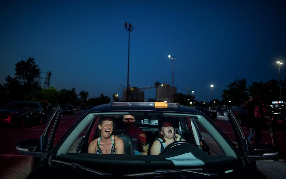 "Socially-distanced music fans watch a performance by rock band ""Monster Truck"" at a drive-in concert in Toronto - CARLOS OSORIO/REUTERS"