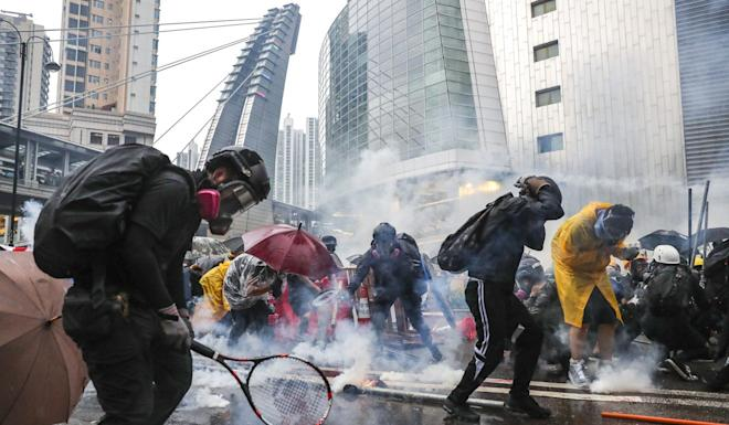 Protesters defend themselves against tear gas in Tsuen Wan during a standoff with police on August 25. Photo: Sam Tsang