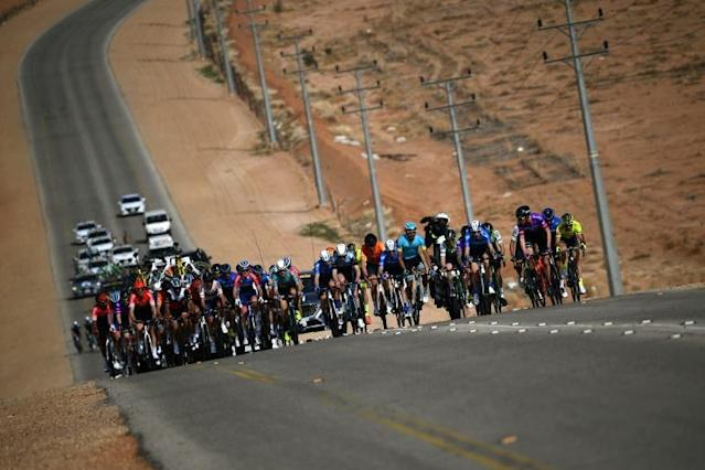 The pack rides during the first stage of the Saudi Tour (AFP Photo/Anne-Christine POUJOULAT)
