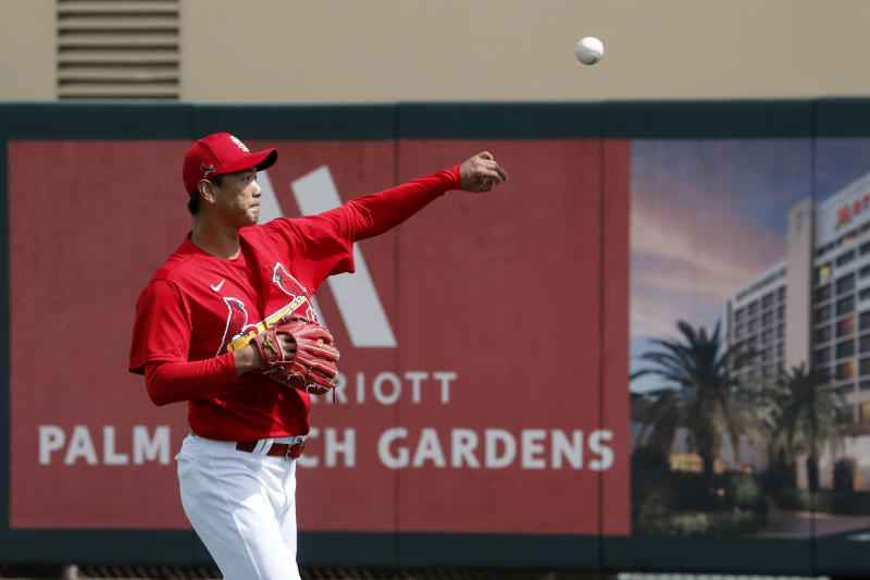 St. Louis Cardinals pitcher Kwang-Hyun Kim warms up before the start of a spring training baseball game against the Miami Marlins Wednesday, Feb. 26, 2020, in Jupiter, Fla. (AP Photo/Jeff Roberson)