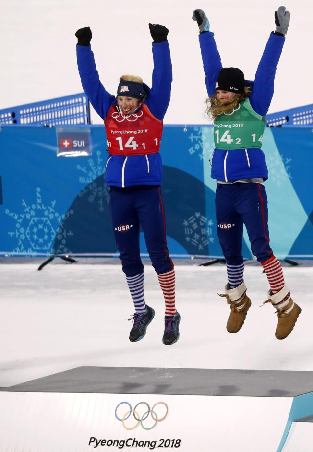 Cross-Country Skiing - Pyeongchang 2018 Winter Olympics - Women's Team Sprint Free Finals - Alpensia Cross-Country Skiing Centre - Pyeongchang, South Korea - February 21, 2018. Gold medalists Kikkan Randall and Jessica Diggins of the U.S celebrate during the victory ceremony. REUTERS/Kai Pfaffenbach