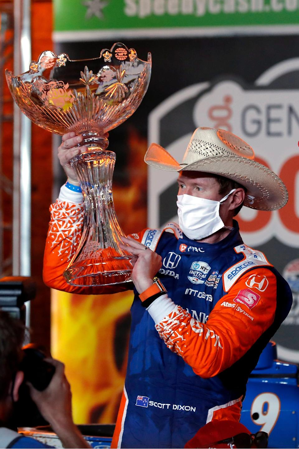 Scott Dixon holds up the winner's trophy after winning at Texas Motor Speedway on June 6, 2020.