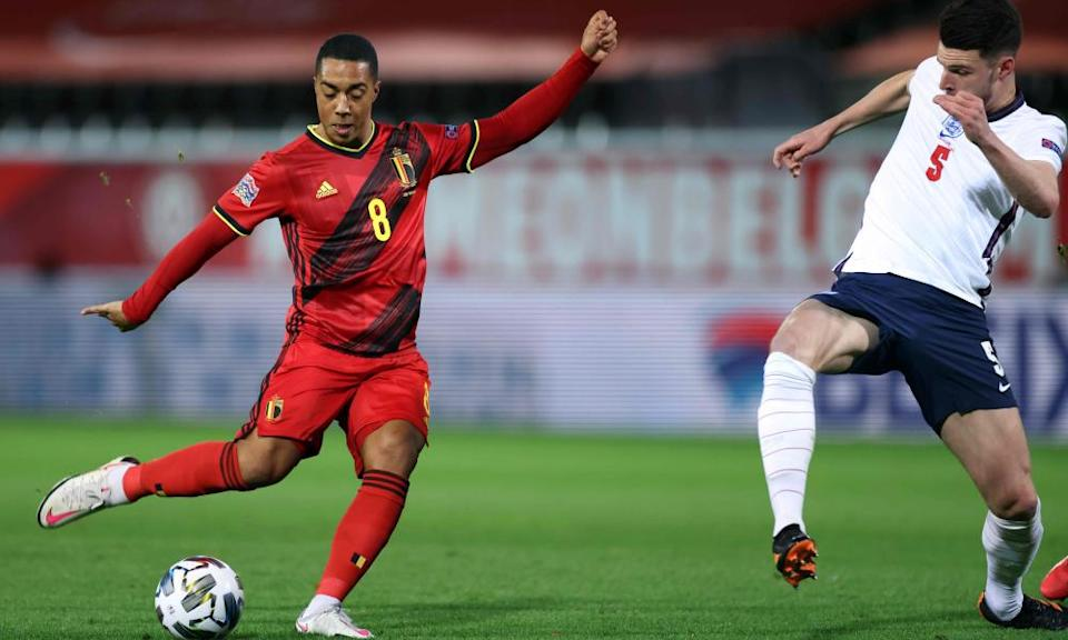 Belgium's Youri Tielemans (left) scores the opening goal against England on Sunday despite Declan Rice's attempt to block his shot.
