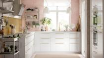 """<p>High gloss cabinets in clean, geometric lines can become quite clinical without any balancing factors. Here, the textured pink wall and gold splashback, with an assorted display of kitchenware, herbs, and fresh plants offset the simple IKEA cabinets for a soft and welcoming kitchen.</p><p>Pictured: <a href=""""https://go.redirectingat.com?id=127X1599956&url=https%3A%2F%2Fwww.ikea.com%2Fgb%2Fen%2Fcat%2Fmetod-base-cabinets-23607%2F&sref=https%3A%2F%2Fwww.housebeautiful.com%2Fuk%2Fdecorate%2Fkitchen%2Fg37409102%2Fwhite-kitchen%2F"""" rel=""""nofollow noopener"""" target=""""_blank"""" data-ylk=""""slk:Metod kitchen units at IKEA"""" class=""""link rapid-noclick-resp"""">Metod kitchen units at IKEA</a></p>"""