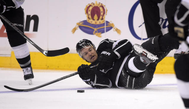 Los Angeles Kings center Trevor Lewis falls as he passes the puck during the first period in Game 6 of an NHL hockey first-round playoff series against the San Jose Sharks, Monday, April 28, 2014, in Los Angeles. (AP Photo)