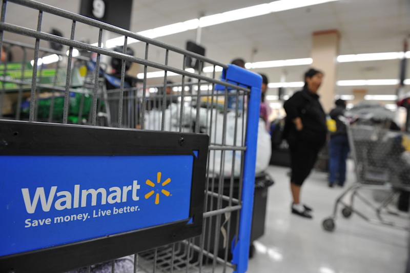 Shoppers wait in line to pay for their purchases at a Walmart store in Los Angeles, California on November 24, 2009. Walmart stores will be open on Labor Day this year. | Robyn Beck—AFP/Getty Imates
