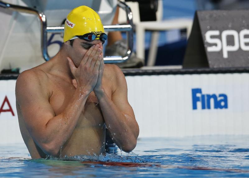 Australia's Christian Sprenger reacts after winning the gold medal in the Men's 100m breaststroke final at the FINA Swimming World Championships in Barcelona, Spain, Monday, July 29, 2013. (AP Photo/Michael Sohn)