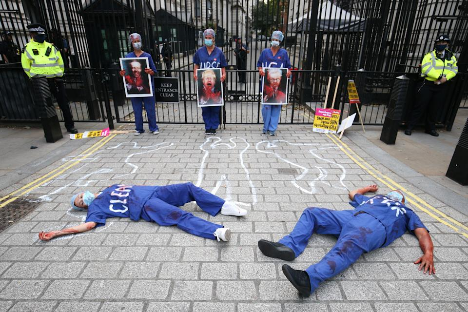 NHS workers stage a die-in outside Downing Street, London, attending a rally to demand the government give them a 15 per cent pay rise.