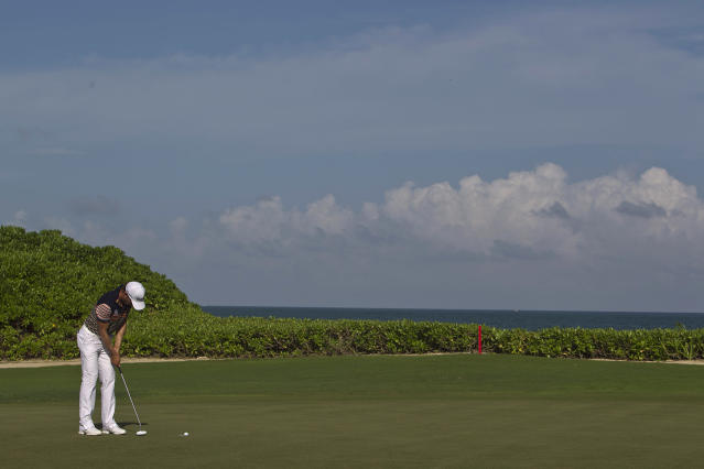 Camilo Villegas, from Colombia, plays the ball on the fourth green during the third day of the OHL Classic at Mayacoba golf tournament in Quintana Roo, Mexico, Saturday, Nov. 16, 2013. (AP Photo/Christian Palma)
