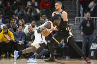 Los Angeles Clippers forward Montrezl Harrell (5) drives on Atlanta Hawks center Alex Len (25) in the first half of an NBA basketball game Wednesday, Jan. 22, 2020, in Atlanta, Ga. (AP Photo/Brett Davis)