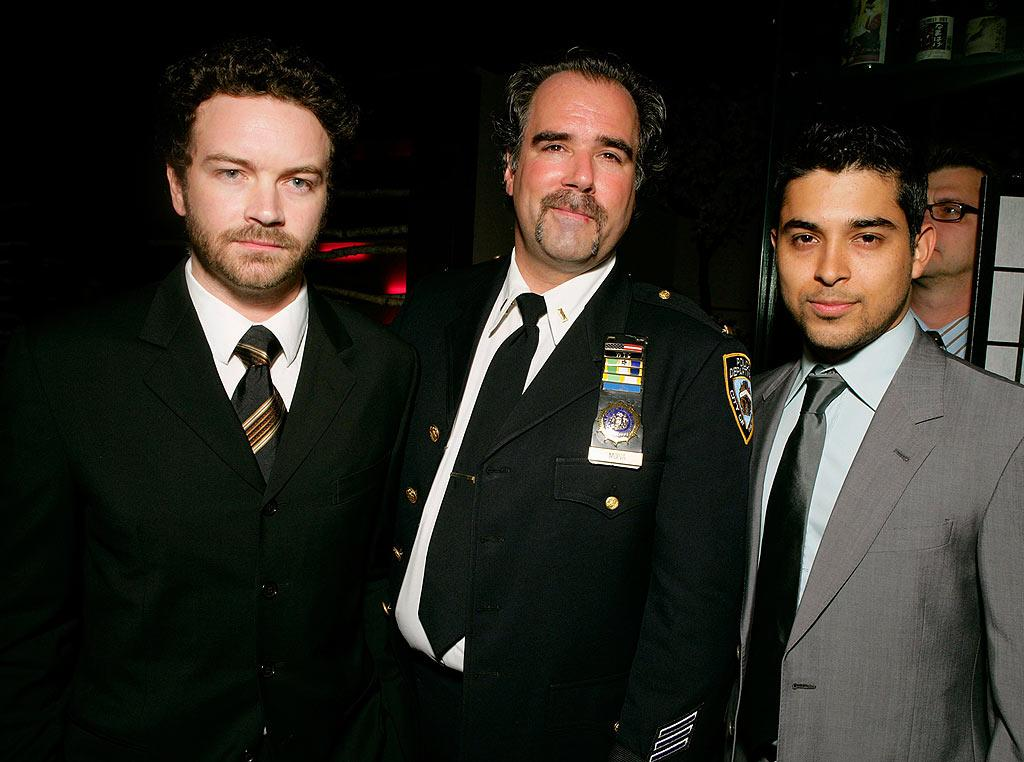 "Danny and his former ""That 70s Show"" costar, Wilmer Valderrama, pose with Steve Mona, a member of the New York Police Department. Todd Williamson/<a href=""http://www.wireimage.com"" target=""new"">WireImage.com</a> - March 27, 2008"