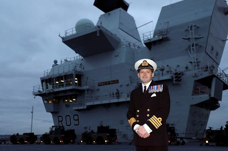 Commanding officer Captain Darren Houston on the aircraft carrier (PA)