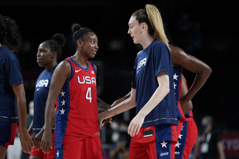 United States's Jewell Loyd (4) celebrates with teammate Breanna Stewart, right, at the end of a women's basketball quarterfinal round game against Australia at the 2020 Summer Olympics, Wednesday, Aug. 4, 2021, in Saitama, Japan. (AP Photo/Charlie Neibergall)